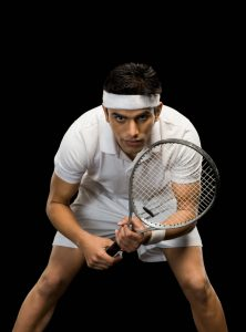 Tennis player practicing with a tennis racket